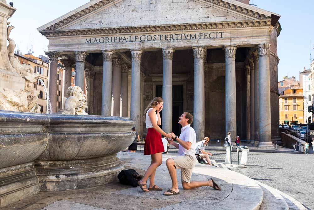 Knee down wedding proposal taking place at the Roman Pantheon in Rome Italy