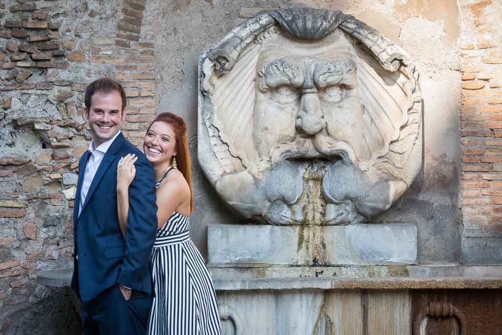 Couple portrait picture taken in front of a scenic roman water fountain