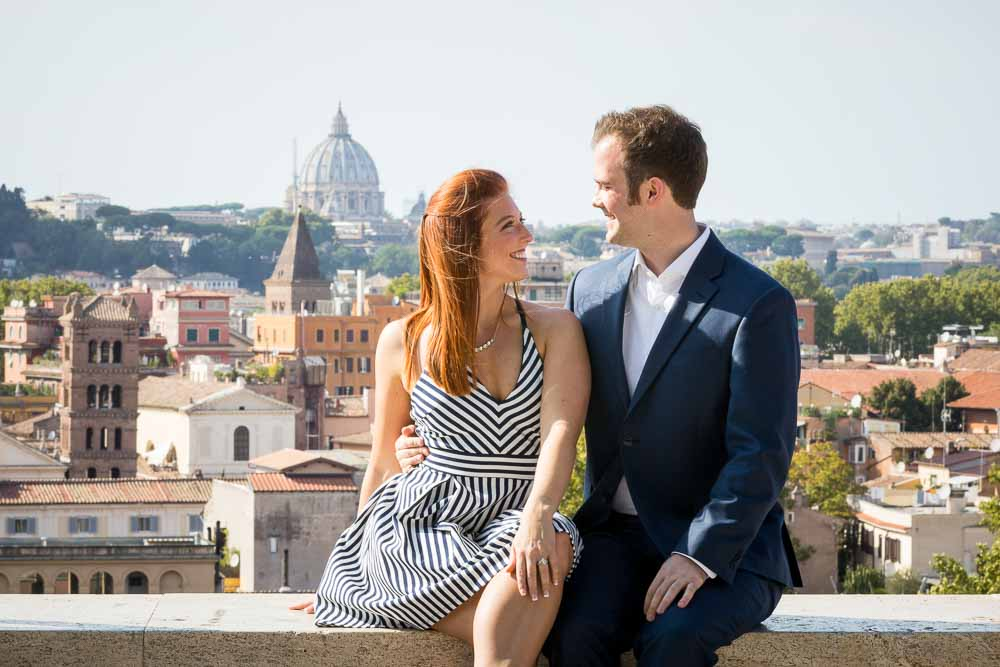 Just engaged posing in the forefront of S.Peter's basilica in the background