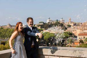 Engagement celebration splashing around prosecco wine
