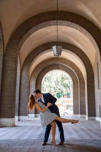 Romantic posed photo of a couple underneath geometrical arches