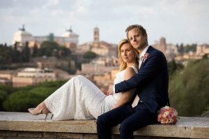 Sitting down before the sweeping view of Rome after the marriage ceremony