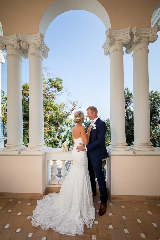 Inside balcony photography of newlywed couple