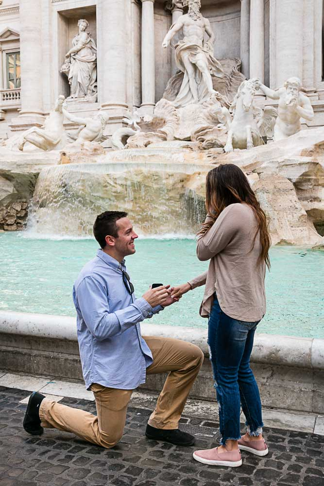 Surprise wedding proposal at the Trevi fountain in Rome Italy