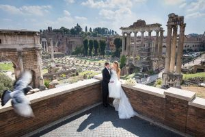 Just married and taking pictures in the ancient roman city with the ruins and monument sin as backdrops