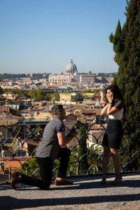 Man knee down marriage proposal overlooking the roman skyline