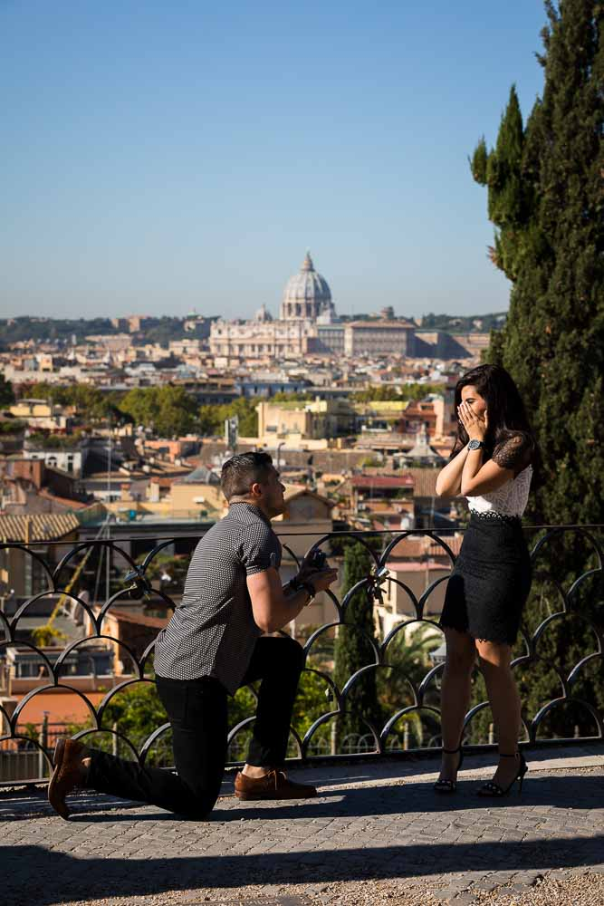 Man knee down marriage proposal overlooking the roman skyline