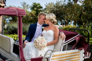 Groom and bride inside ape mini cart