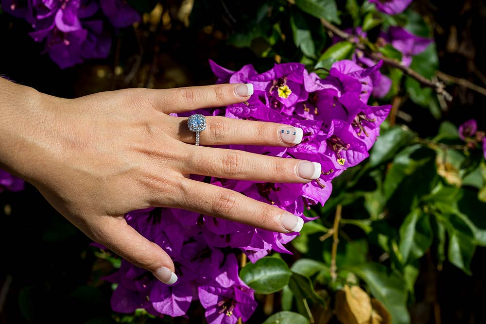 Macro close up engagement ring over purple flowers