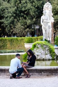Candid shots taken during a surprise wedding proposal taking place at the Villa Borghese gardens in Rome Italy