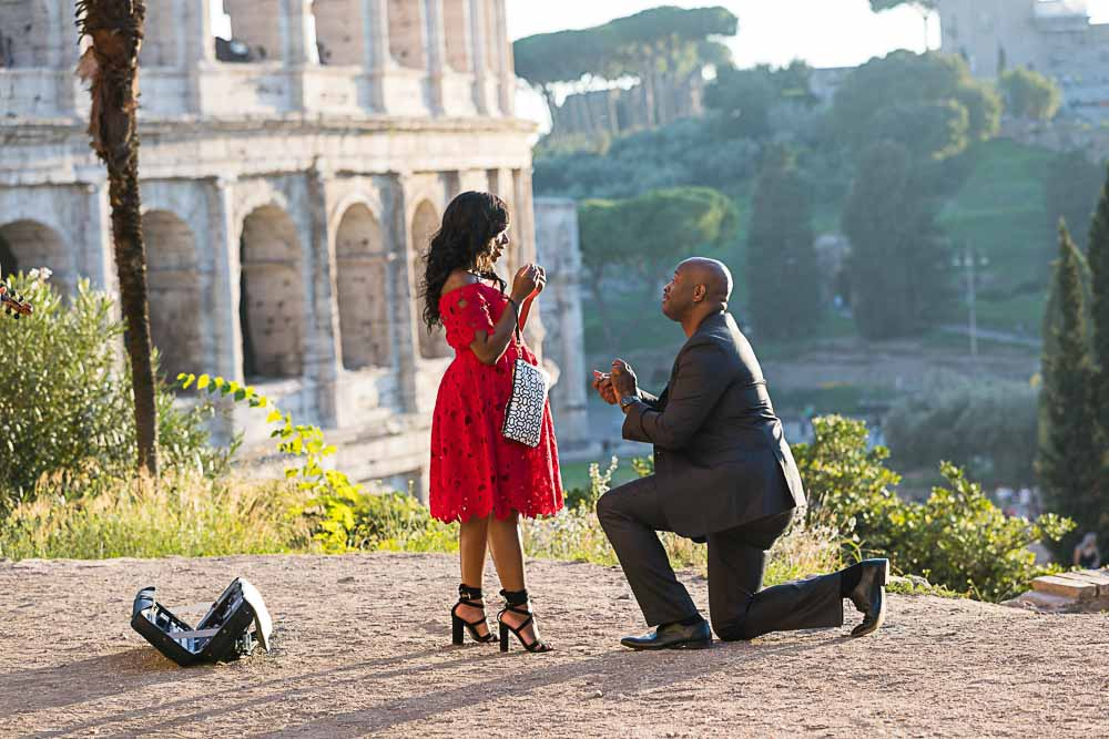 Roman wedding marriage proposal out on a hillside view over the Colosseum
