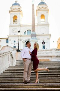 Posing on the Spanish steps during a pregnancy photo session in Rome