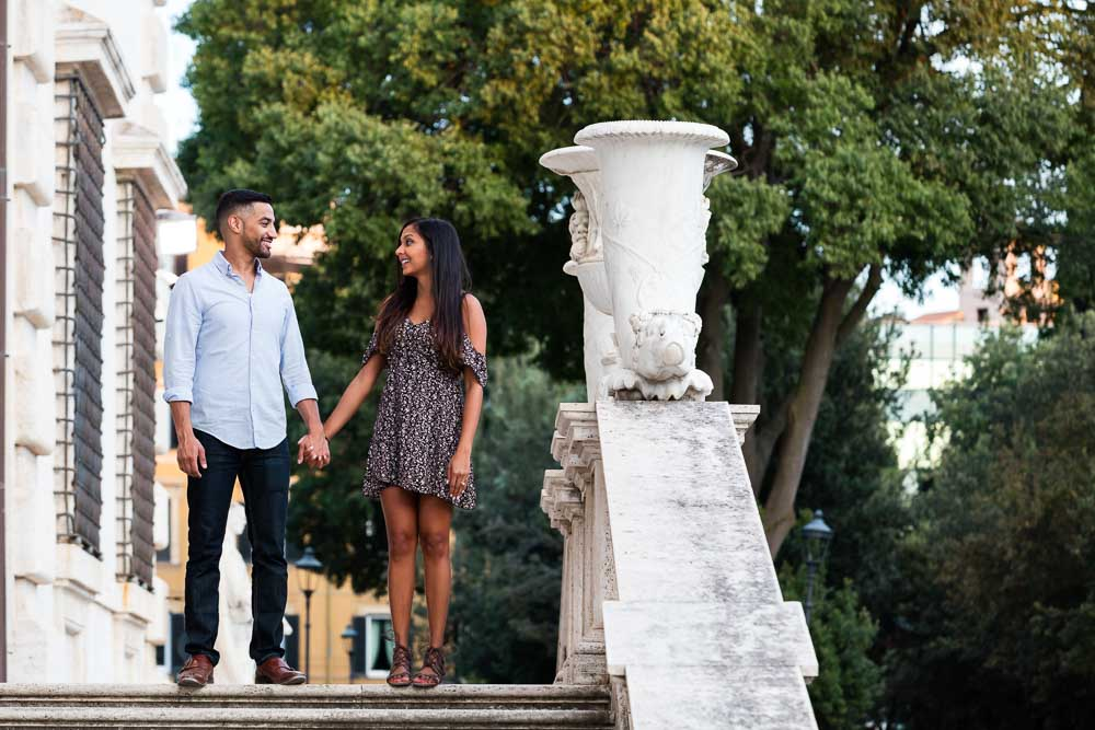 Couple photo session standing on marble staircases
