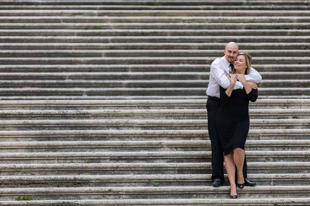 Couple happily posing together on a large staircase
