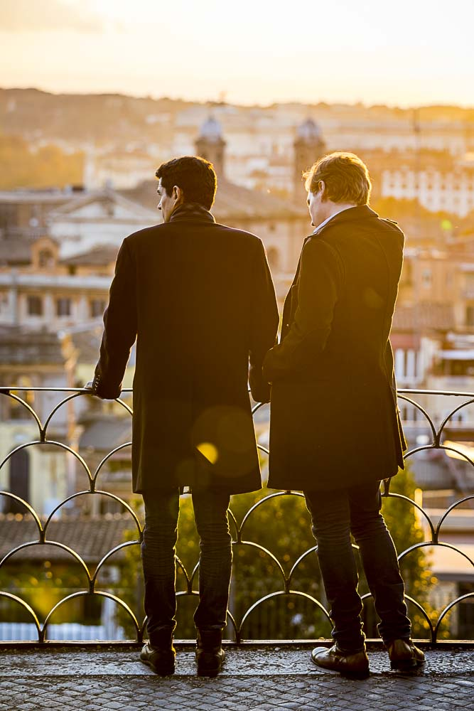 Couple together looking at roman skyline at sunset