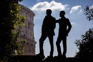 Side ways profile male couple silhouette at the Colosseum
