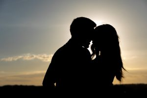 Silhouette image of a couple at sunset