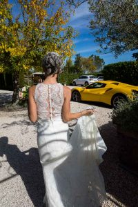 Bride walking and leading to the wedding car