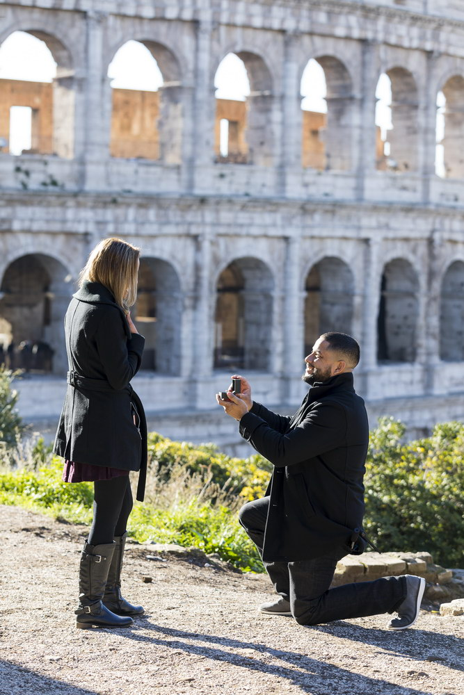 Knee down wedding marriage proposal at the Roman Colosseum