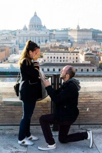 Man proposing marriage overlooking the roman skyline from above