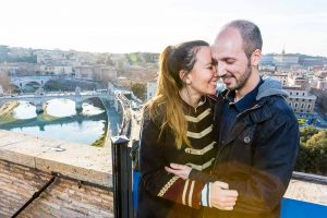 Couple portrait happily together overlooking the roman rooftops