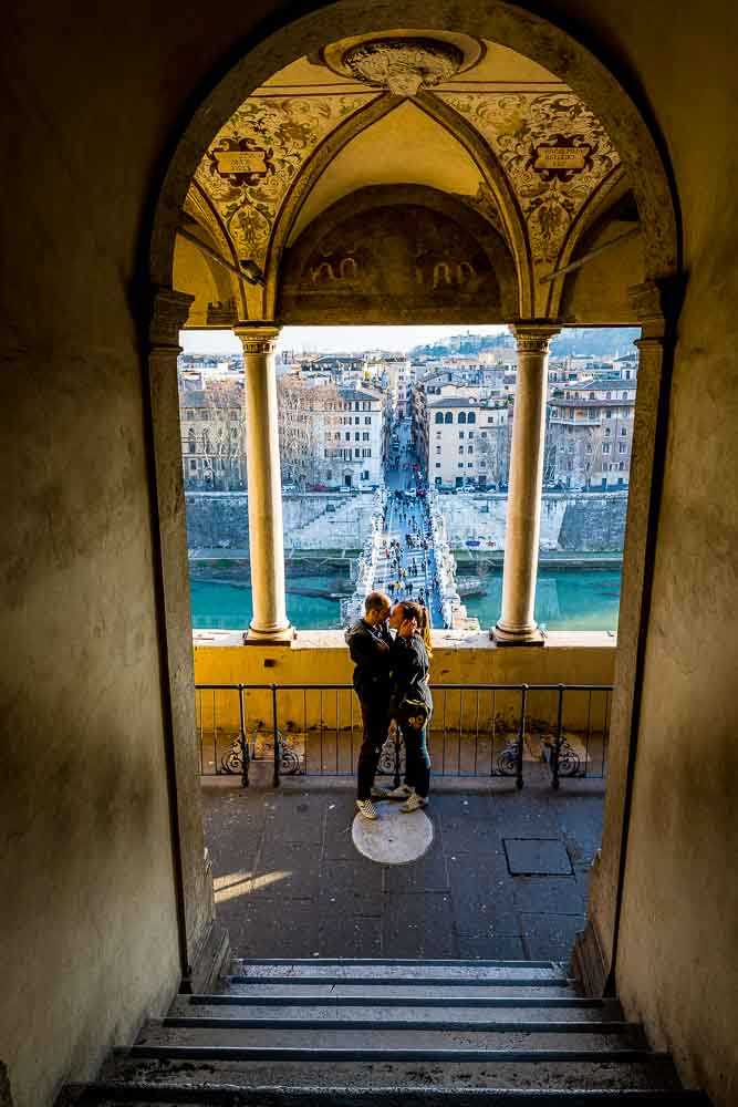 Posed couple during an engagement photography session inside the a castle