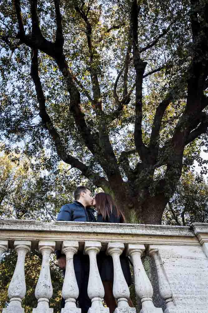 Romantic kiss under tree