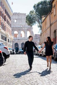 Walking in a roman alleyway with the Coliseum in background
