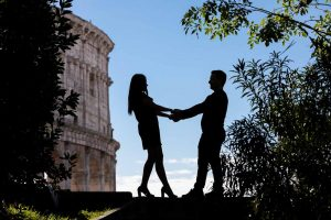 Silhouette image of a couple holding hands at the Roman Colosseum. Image by Andrea Matone photography studio. Rome, Italy