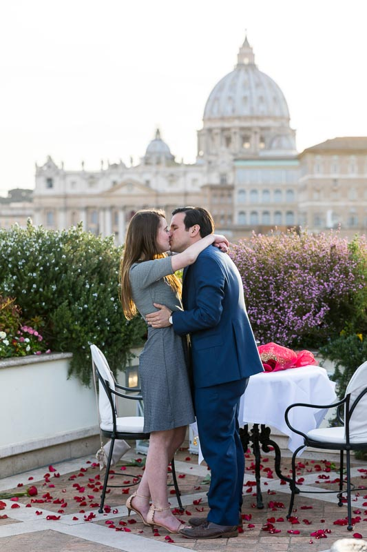 Couple kissing with Saint Peter's dome in the far distance