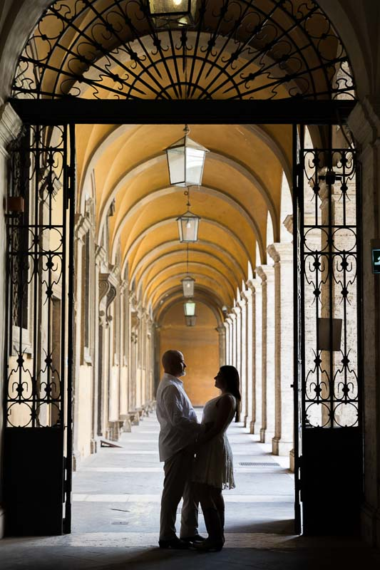 Silhouette image of a couple standing under portico