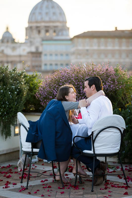 Happy together on a terrace with a scenic roman view