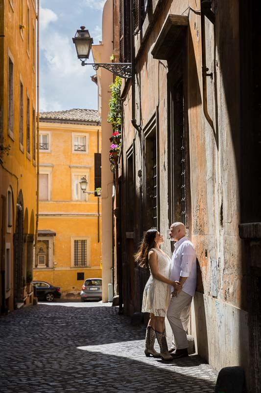 Romantic photoshoot in the roman cobble stone street alleyways. Image by Andrea Matone photographer