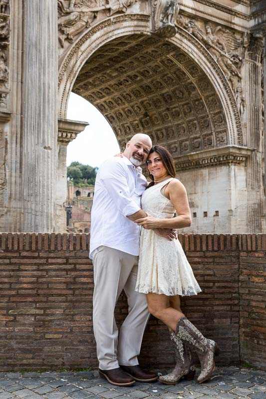 Portrait picture standing close to one another under an ancient roman arch