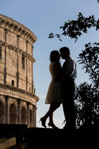 Posed image in front of the Roman Colosseum in silhouette