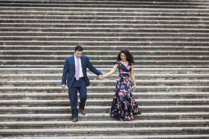 Descending stairs holding hands