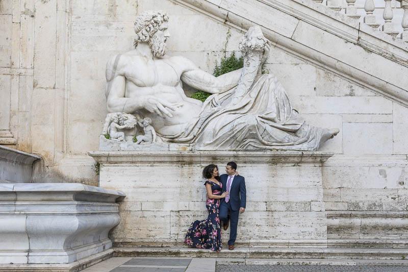 Portrait picture taken below an ancient marble statue in Piazza del Campidoglio