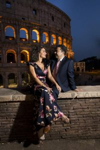 Sitting down on a ledge at night in Rome Italy