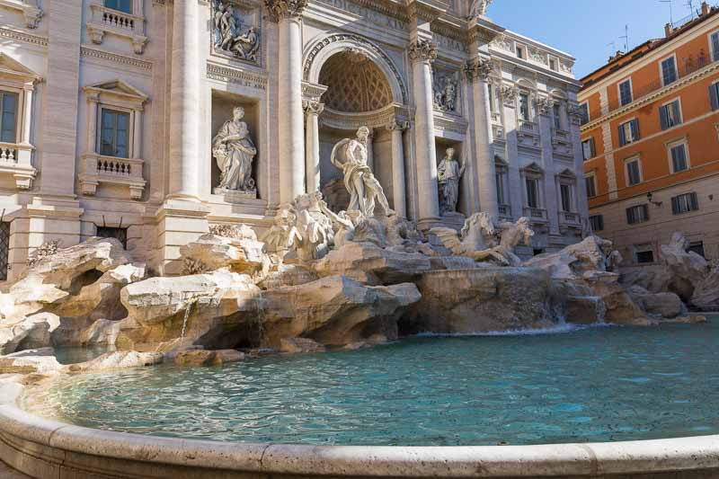 A picture of the Trevi fountain photographed in the early morning as the light started to shine through