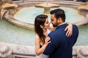 Portrait couple picture taken at the Barcaccia water fountain in Rome Italy
