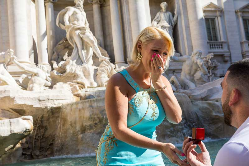A great deal of joy happiness and surprise for this romantic wedding proposal at the Trevi fountain in Rome Italy