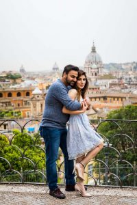 Together overlooking the city of Rome from the above Parco del Pincio terrace view