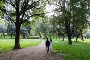 Walking in the park together during a pre wedding photo session