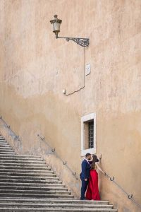 Romantic image of a couple together under a typical roman light pole