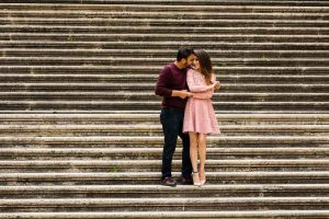 Couple posed on a staircase