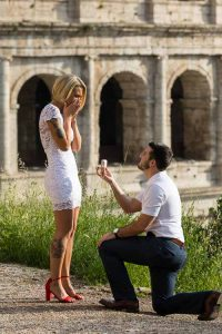 knee down wedding proposal at the Coliseum in Rome Italy