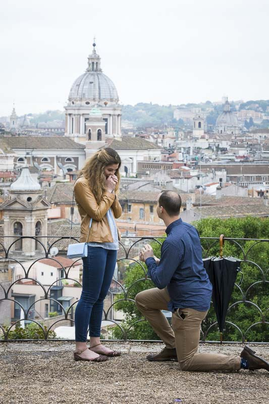 Man knee down Rome Marriage Proposal taking place at the belvedere park terrace overview
