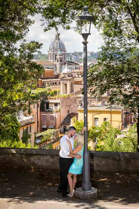 Love story engagement session with the roman rooftops in the far background