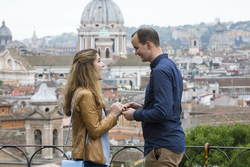 Putting the engagement ring on the hand with joyful surprise