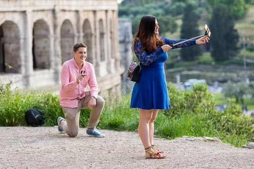 Setting up the selfie stick for a couple photo